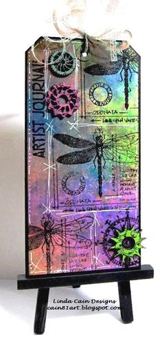 Large tag with Spray Inks and stamps.