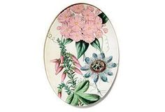 Inspired by an antique botanical print, this stunning plate features softly hued blooms.