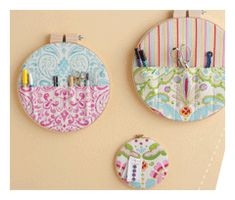 sewing room storage pockets with fabric scraps in a variety of embroidery and quilt hoops cheap at thrift shops