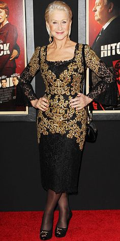 Helen Mirren wearing an embroidered Dolce & Gabbana sheath with black and gold accessories.