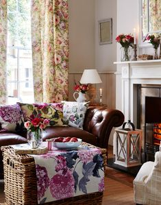 Floral curtains are a great way to show the fabric in a country living room.