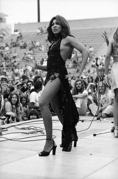 Tina Turner on stage in 1978 (born November 26, 1939) a singer, dancer, actress, and author, whose career has spanned more than half a century, earning her widespread recognition and numerous awards. Born and raised in the Southeastern United States, she is now a Swiss citizen.
