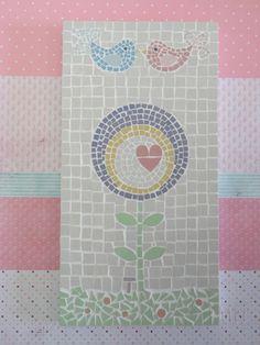 Quadro de Mosaico Flor Patch #4. Inspirado em trabalhos delicados de Patchwork. <br>Design exclusivo, feito pela mosaicista Tainah Neves. <br> <br>Mosaico feito à mão com Pastilhas de Porcelana. <br> <br> <br>Dimensões: 31 cm x 16 cm, espessura 1,3 cm.