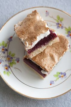 ... blackberry curd nestled between buttery almond shortbread and pillowy