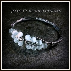 Handmade Wire Wrap White Cat's Eye Bracelet. Starting at $9 on Tophatter.com!