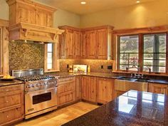 BEAUTIFULLY FINISHED HOME WITH WALNUT FLOORING, WINE BAR/CELLAR, RECLAIMED AND HAND PEELED LOG ACCENTS. KITCHEN FEATURES 6 BURNER VIKING RANGE, VIKING DISHWASHER, AND FARMHOUSE SINK. 2139 E. River Rd., Livingston, MT 59047 #VikinginMT