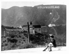 """The HOLLYWOODLAND sign was erected in 1923 to advertise a new housing development in the hills above the Hollywood district of Los Angeles. In 1949 the Hollywood Chamber of Commerce contracted to repair and rebuild the sign. The contract stipulated that """"LAND"""" be removed to reflect the district, not the housing development."""