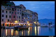 Houses reflected in harbor at dusk, Portofino. Liguria, Italy (color)