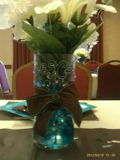 Custom stenciled centerpieces for turquoise & brown baby shower