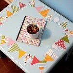 $1 Mod Podge pennant art table.