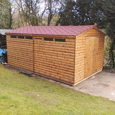 Garden workshop, 16 x 10 Log Lap, shingles on roof made by Davies Timber Wales Ltd