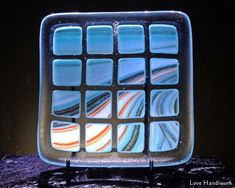 This is a (approximately 5 square slumped fused glass bowl shaped dish. It is a clear dish with squares streaked with turquoise green, orange, and white on it in rows. Bottle Slumping, Fused Glass Bowl, Glass Beer Mugs, Square Plates, Black Abstract, Green And Orange, Hostess Gifts, Squares, Glass Art
