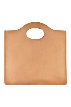 """Define your simple aesthetic with the Minimalist Tote. Luxurious raw edged leather takes center stage with a soft warm finish and a stand-out simple style. A sophisticated circle handle is cut out for you to grab and go. Genuine cowhide leather Unlined interior 15"""" L x 15"""" W Minimalist Leather Tote by Kiko Leather. Bags - Totes California"""