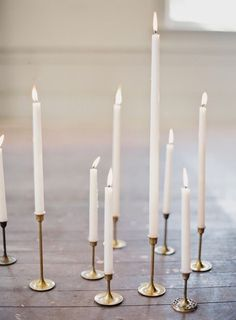 Simple white candles for table centres