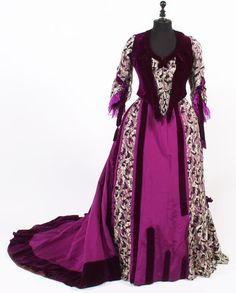 A circa 1896 dark purple and floral afternoon dress.   Worn by Anne Basil Jones, the wife of William Basil Jones, the Bishop of Saint Davids, Pembrokeshire between 1874-97, the last of the Welsh Bishops to sit in the House of Lords.