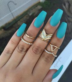 These matte aquamarine nails are the bomb! Matte, yes! Simple, yes! But absolutely eye-catching especially with those gold rings.