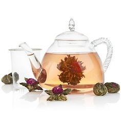 "Padma Lakshmi ""Neela"" glass teapot. Made with the same kind of glass used in a chemistry lab so you can keep your tea warm by putting it directly on the stove! Plus, love that you can see the blooming tea"