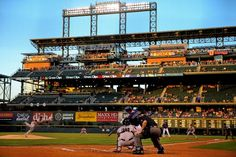DENVER, CO - SEPTEMBER 2: Corey Dickerson #6 of the Colorado Rockies hits an RBI double off of starting pitcher Yusmeiro Petit #52 of the San Francisco Giants during the first inning at Coors Field on September 2, 2014 in Denver, Colorado. (Photo by Justin Edmonds/Getty Images)