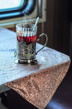 A Russian silver tea holder and table glass -- sophistication in every sip!