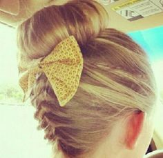 Sock bun bun, with that really fun arm tiring braid in the back with a bow...still have no idea where girls find those