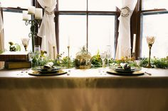 Www.clevents.ca #chantillylaceevents #cldesigns #falldecor #fallwedding #falltablescape #champagne #gold #ivory #greenery #greenswag #mixandmatch #homedecor #candleabra #candlesticks #bronze #goldchargers #greenplates #tablesetting