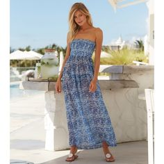 Isla Bandeau Dress Zanzibar. £45 A stylish beach cover up, this classic bandeau maxi dress is designed with movement and wearability in mind. With elastic shirring at bust, it's perfect to slip on over your swimwear.