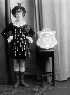 Possibly Miss Cullen, in Scottish dance costume displaying medals and shield - Auckland NZ - 12 January 1925?.