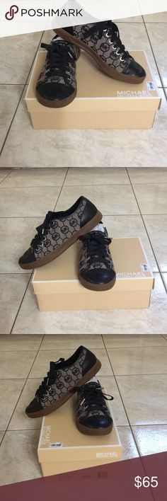 Beautiful Michael Kors Sneakers Sz 8 1/2M Beautiful Michael Kors CIty sneakers. MK monogram jacquard size 8 1/2 practically new with box and tissue packing.  Excellent condition! From a smoke/pet free home. Very comfortable! Michael Kors Shoes Sneakers