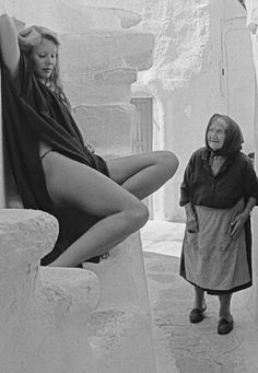 #Steets of #Mykonos ,1974. The local lady  Is starring at the tourist .