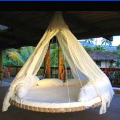 Recyle an old trampoline into a lovely swing bed!!!-I want one of these on my new deck!!