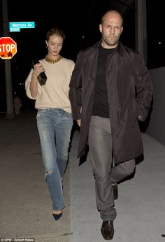 model couple: Rosie Huntington-Whiteley dresses down in jumper and ripped jeans for date night with Jason Statham