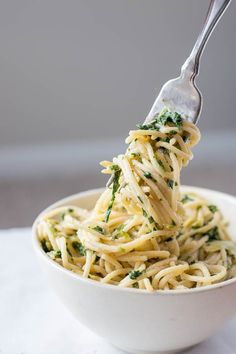 This Creamy Spinach Artichoke Hummus Pasta is a healthy, gluten free, and vegan 10 minute meal! You'll love this play on the classic spinach artichoke dip!