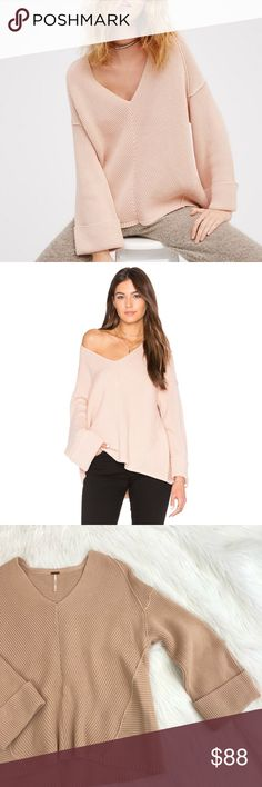 NWOT Free People La Brea V Neck Sweater NWOT Free People La Brea V Neck Sweater - thick, ribbed fabric, v neck, fold over sleeves, oversized, slouchy fit. Color on the model and the item for sale are the same, however it is more of a muted light pink in person as can be seen in my pics. Size S.  Measurements:  - Bust: Pit to pit, approx. 22in.  - Length: Shoulder to hem, approx. 24in.  Condition:  - New without tags, new and never worn. Free People Sweaters V-Necks