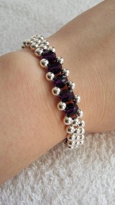 This beautiful bracelets is handmade by silver plated and amethyst crystal beads. Its fit in any occasion and perfect gift for you and your friends.