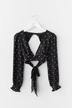 Woven polka dot crop top, with a low-cut V front and an open back. Bow-tie back strap closure. Non-stretch material. 72% Rayon 28% Polyester Imported