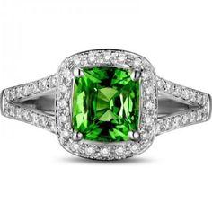 Beautiful 2 Carat cushion cut Emerald and Diamond Halo Ring in 10k White Gold showcases 1.25 carat cushion cut Green Emerald in the center