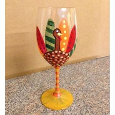 The Turkey Wine Glass features ahand painted turkey with his feathers colorfully displayed on the wine glass. The Turkey Wine Glass is a perfect for a turkey dinner any time but especially at Thanksg