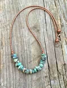 Raw, genuine turquoise chips and focal pieces with copper Czech glass seed beads and rustic, antiqued copper accents. This necklace is 18 in length as shown and may be adjusted upon request.