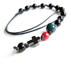 10 Hand knotted beads of Natural Black Obsidian with Ruby, Bloodstone, Tourmaline along with Hematite Cross gives supreme chanting experience with their respective metaphysical properties for a supreme chanting experience. Artist And Craftsman, Prayer Beads, Handicraft, Terracotta, Supreme, Desi, Turquoise Bracelet, Beaded Bracelets, Brass