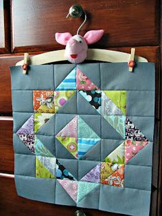 "Could use this for a baby quilt: use charm squares, neutral background, and maybe two borders to pick up some colors from the prints and make it ""baby size"".   OR, it could be a lovely table topper..."