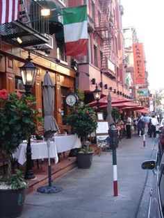 "Il Cortile in Little Italy, NY. Enjoy their ""power lunch"" Northern Italian dishes while you sit outside and watch the passerbys on a beautiful day."
