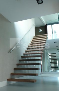 Straight staircase, wooden treads.