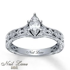 A marquise diamond dazzles as the show-stopping star of this beautiful engagement ring by Neil Lane Bridal®. Round diamonds and milgrain lend vintage-inspired elegance to the top and sides of the 14K white gold band to complement. The ring has a total diamond weight of 3/4 carat. Diamond Total Carat Weight may range from .69 - .82 carats.