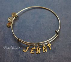 This Alex and Ani inspired personalized bangle bracelet is one of the hottest trends right now. Spell out your initials or name in your choice