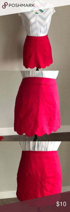 "Scalloped pink skirt Super cute scalloped pink skirt. Lighting makes the skirt look more red, but it's more of hot pink color. Has a zipper on the side. Has been worn but in great condition, just needs a bit of steaming to get the wrinkles out. No tears, rips or stains.  Length: 15"" Waist: 15"" Lush Skirts Mini"