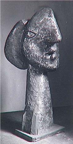 Sculpture by Picasso, 1932, Marie-Thérèse head with long neck, copper. Photo by Brassaï.