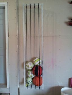 Ball Storage For The Garage. Love The Use Of The White Wire Shelves With  The Bungee Cords.
