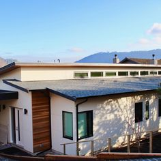 Deep Cove home we did last summer with plentiful windows and a stunning view in the back.