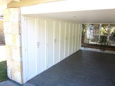 Carport idea. Bank of storage cupboards to store mower, garden tools etc.