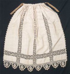 """Apron, Italy, 1550-1600  Aprons were commonly used for housework. This example, embellished with fine lacework and with a later belt, could have been made in the home.""    ""Tabby linen with lacework, h 90cm, w 90cm, belt 87cm. Museo del Tessuto, Prato"""